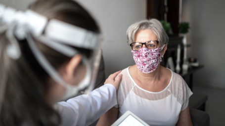 doctor and patient in masks at checkup