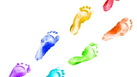 Rainbow foot prints kid colorful set isolated on white background. Many fingerprint or stamp texture artwork of kids for education and journey. Bottom view. Close up.
