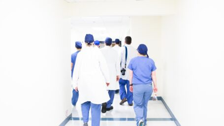Medical team walking down hallway