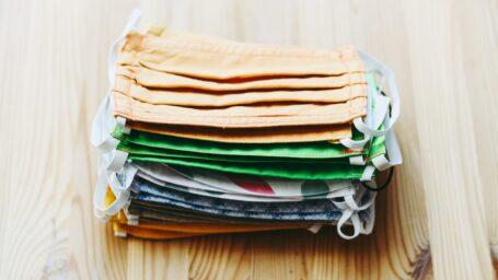 Handmade cloth masks in a pile