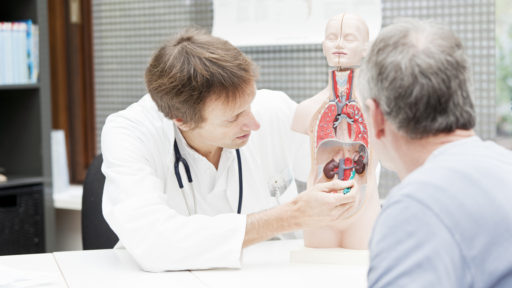 Image of a doctor explaining urological problems to a patient.