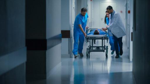 Doctors, Nurses and Paramedics Push Gurney