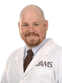 David V. Strain, M.D.
