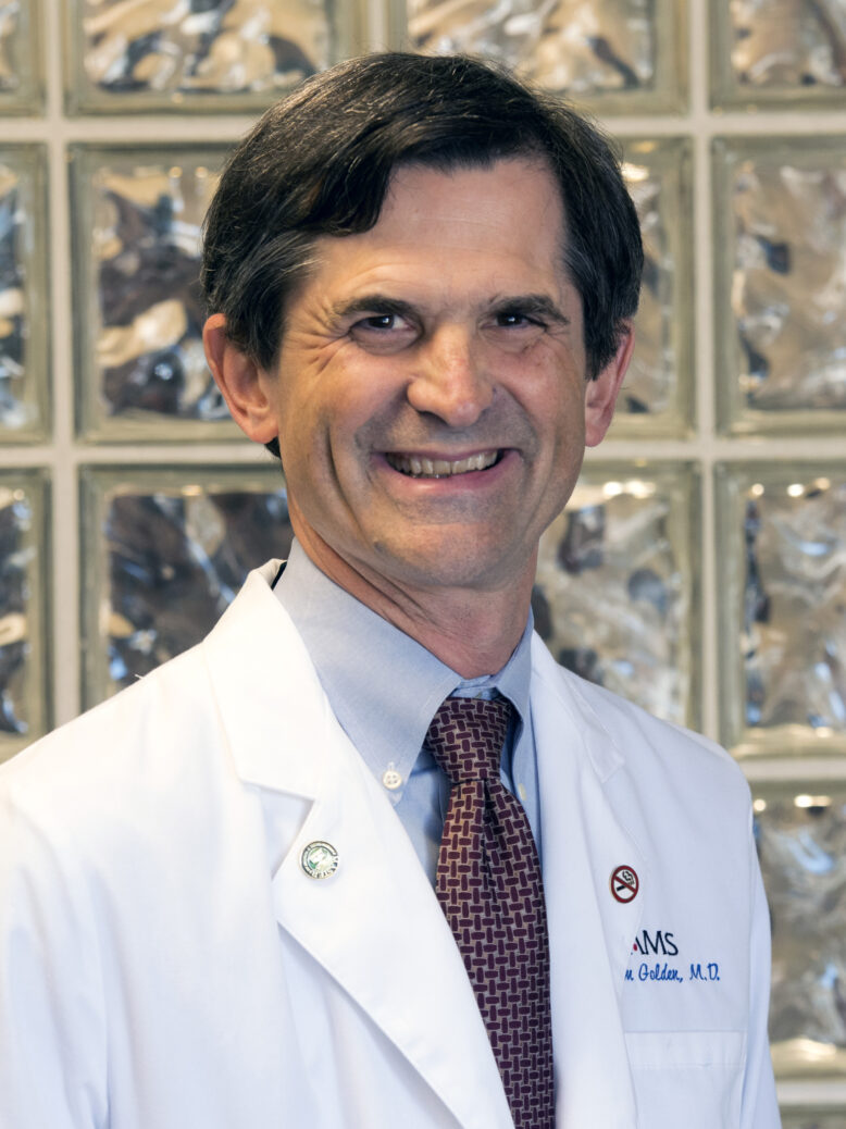 William E. Golden, M.D.