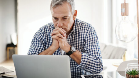 Older man sitting at a laptop
