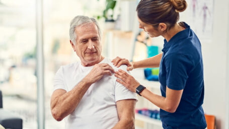 Cropped shot of a female physiotherapist working with a senior male patient