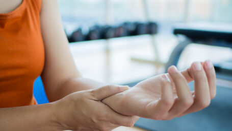 Woman with hand and wrist injury in the gym.