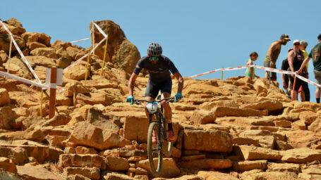 Man descending rocky hill on mountain bike